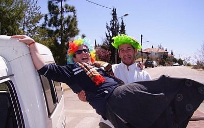 Purim offers some serious reasons for laughter. (Yoel Ben-Avraham/Creative Commons via JTA)