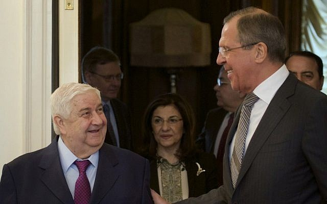Russian Foreign Minister Sergey Lavrov (right), welcomes Syrian Foreign Minister Walid Moallem (left), in Moscow, February 25, 2013. (AP/Ivan Sekretarev)