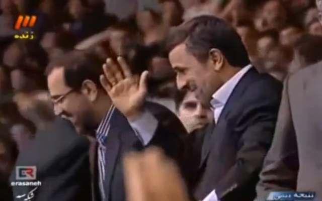 Iranian President Mahmoud Ahmadinejad waves to spectators at a wrestling match in Tehran on February 23, 2013. (photo credit: image capture/YouTube video)