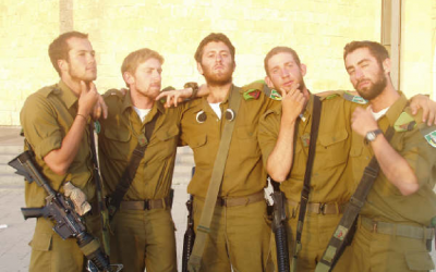 Seth Freedman, center, channeled disenchantment with Israel and his IDF service into a popular online column for Britain's Guardian newspaper. (Courtesy of Seth Freedman)