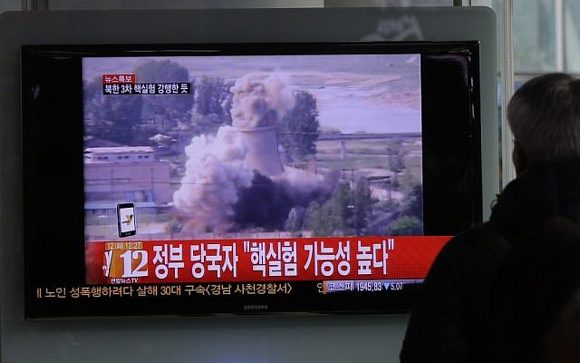 A South Korean man watches TV news showing file footage of North Korea's nuclear test at the Seoul train station in Seoul, South Korea, Tuesday, Feb. 12 (photo credit: AP /Lee Jin-man)