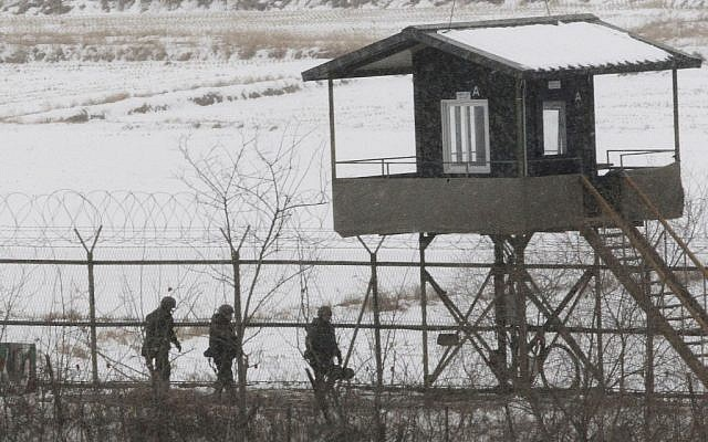 South Korean army soldiers patrol along a barbed-wire fence at the Imjingak Pavilion, near the demilitarized zone of Panmunjom, in Paju, South Korea, Tuesday. (photo credit: AP/Ahn Young-joon)
