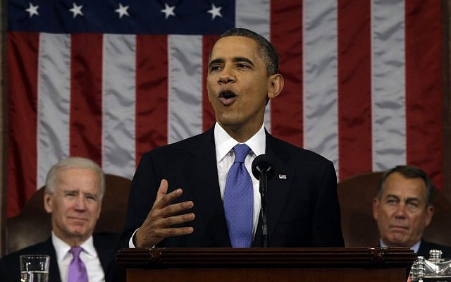 US President Barack Obama, flanked by Vice President Joe Biden and House Speaker John Boehner of Ohio, gestures as he gives his State of the Union address during a joint session of Congress on Capitol Hill in Washington, Tuesday Feb. 12 (photo credit: AP/Charles Dharapak)