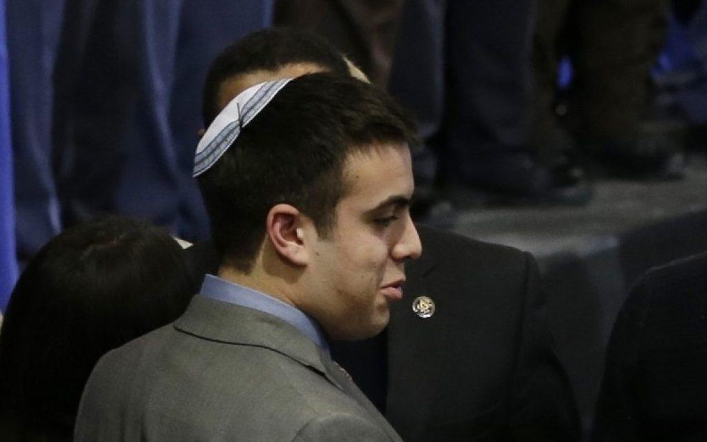 Sami Rahamim waits for an address by President Barack Obama on Monday, February 4, 2013 in Minneapolis. (photo credit: AP Photo/Jim Mone)