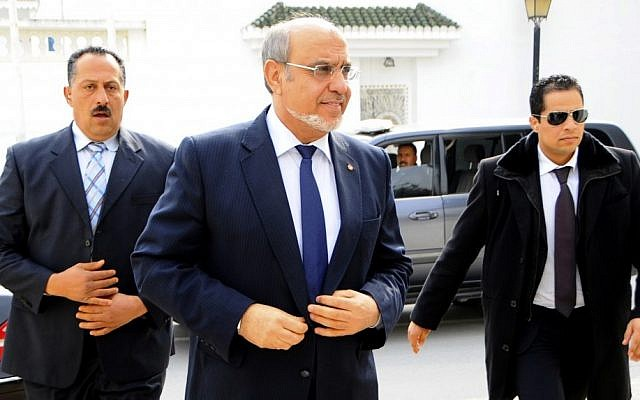 Tunisian Prime Minister Hamadi Jebali, center, arrives for meeting with political parties in an effort to end a crisis exacerbated by a political assassination two weeks ago, outside Tunis, Monday, Feb. 18 (photo credit: AP/Hassene Dridi)