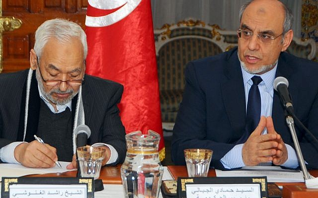 Tunisian Prime Minister Hamadi Jebali, right, is pictured with Ennahda party leader Rached El Ghannouchi at the opening of a meeting with representatives of Tunisian political parties in Carthage, outside Tunis, in February 2013. (photo credit: AP/Hassene Dridi)