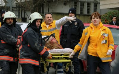 Medical workers carry away a woman injured when a suicide bomber detonated an explosive device at the entrance to the US Embassy in Ankara, Turkey, in early February (photo credit: AP/Burhan Ozbilici)
