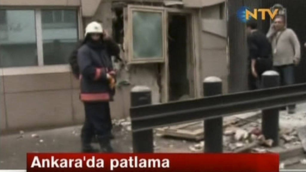 In this image made from video, emergency personnel are seen in front of a side entrance to the US Embassy in Ankara, Turkey, following an explosion on Friday (photo credit: AP/NTV)