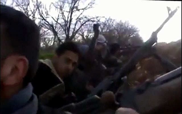 Syrian rebels battle Hezbollah operatives near Qusayr, February 2013. (photo credit: screen capture Muslim Voice/YouTube)