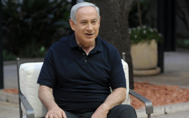 Prime Minister Benjamin Netanyahu sits in the garden of his Jerusalem residence in June 2012. (photo credit: GPO/Flash90)