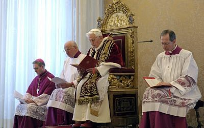 Pope Benedict XVI, third from left, delivers his message at the end of a meeting of Vatican cardinals, at the Vatican, Monday, Feb. 11, 2013. From left are Archbishop Georg Gaenswein, Mons. Franco Camaldo, and Mons. Guido Marini, pope aides. (photo credti: AP/L'Osservatore Romano)