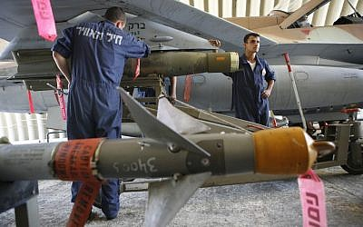 Soldiers affixing missiles to an Israeli jet before a flight over Lebanon in 2006. (photo credit: Nati Shohat/Flash90)