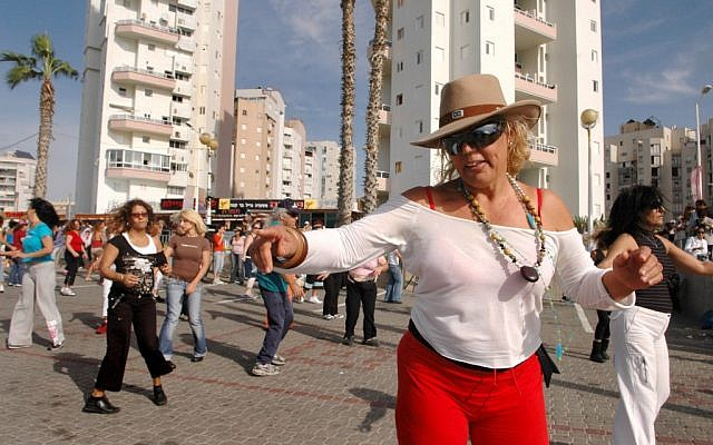 A mixed community in Bat Yam, where Russian immigrants swim in the dead of winter, locals Israeli dance on the boardwalk, and a new stream of urban, artsy Israelis seek lower rents for their studios and living spaces. (photo credit: Yossi Zamir/Flash90)