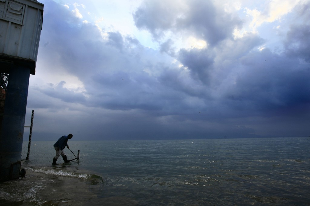 Sea of galilee rises 10 cm after weekend storm the times of israel shuli chen of the national water authority stands in the sea of galilee to take a publicscrutiny Images