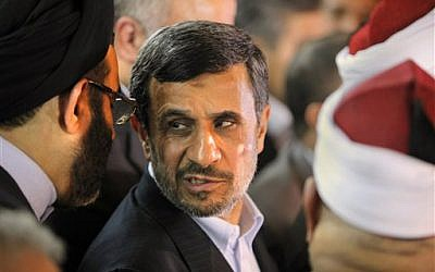 Iranian President Mahmoud Ahmadinejad attends a press conference with Egyptian Sunni clerics at Al-Azhar headquarters in Cairo, Tuesday, Feb. 5, 2013 (photo credit: AP/Amr Nabil)