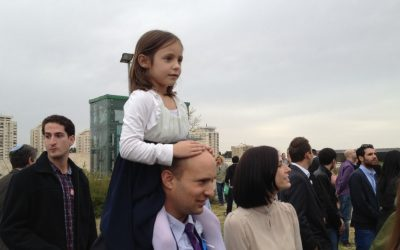 Jewish Home party chairman Naftali Bennett with one of his daughters at the Knesset swearing-in ceremony, Feb. 5, 2013 (photo credit: Raphael Ahren/Times of Israel)