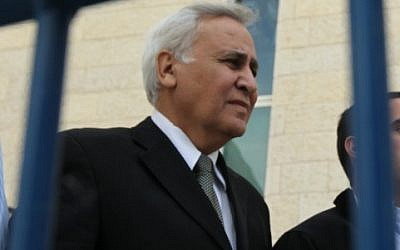 Former president Moshe Katsav leaves the Supreme Court in Jerusalem on November 10, 2011, after being found guilty of rape. (photo credit: Nati Shohat/ Flash90)