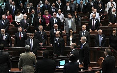 MK's sing the national anthem during the opening session of Israel's 19th Knesset on Tuesday, February 5 (photo credit: Miriam Alster/Flash90)