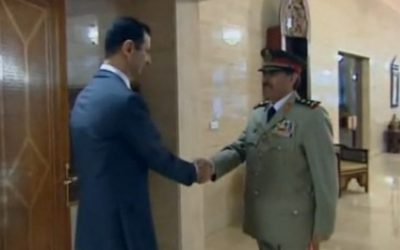 Fahd Jassem al-Freij, with Bashar Assad, on his appointment as defense minister, in July 2012. (photo credit: YouTube screenshot)