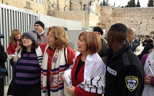 Sachs, Hoffman and Nevo (from right to left), being led to the police station (Photo credit: Mitch Ginsburg/ Times of Israel)