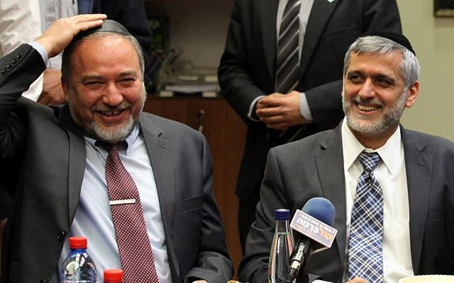 Former foreign minister MK Avigdor Liberman and Shas leader MK Eli Yishai at a celebration for MK Aryeh Deri's birthday, held at the Knesset, February 18, 2013 (photo credit: Flash90)