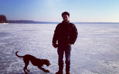 Englander and his dog frolicking on a frozen lake in Madison, Wisconsin (Courtesy Nathan Englander)