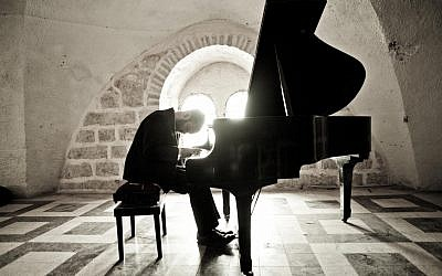Yonatan Razel at the piano, his instrument of choice (photo credit: Ohad Romano)
