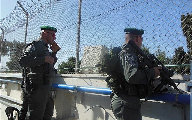 Border Police standing guard on a wall above the tomb (Photo credit: Miriam Adani/ Kever Rachel Fund)