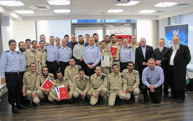 Soldiers, teachers, IAF officials, and rabbis at the MCITP certification graduation ceremony for Haredi soldiers (photo credit: Courtesy)