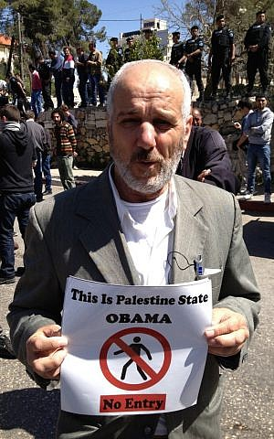 Anti-Obama protester in Ramallah, March 21 (photo credit: Elhanan Miller/Times of Israel)