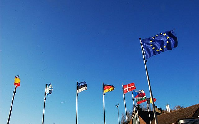 Flags outside the European Union in Brussels (photo credit: Flickr/BY 2.0/motiqua )