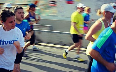 Runners take part in the Tel Aviv half marathon on Friday (photo credit: courtesy of Jonathan Fisch)