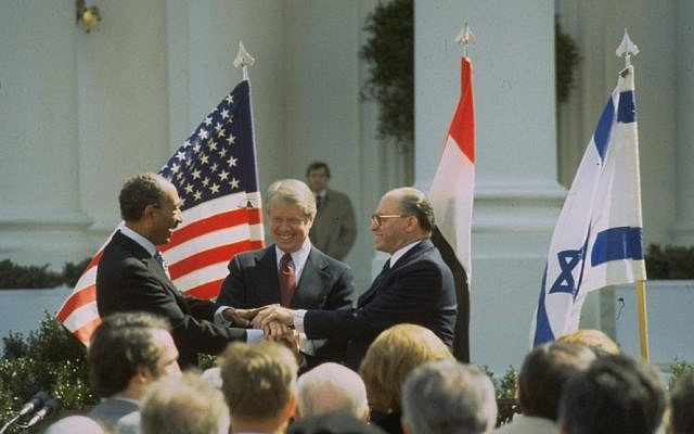 The triple handshake: prime minister Menachem Begin, president Jimmy Carter, and president Anwar Sadat after signing the Israel-Egypt peace treaty in March 1979. (photo credit: GPO/Tal Shabtai)