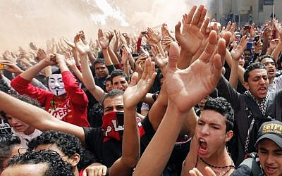 Fans from Egypt's Al-Ahly soccer club celebrate in Cairo on March 9, 2013, after a court confirms death sentences for 21 people over their roles in the deadly 2012 riot in Port Said that left more than 70 people dead. (AP Photo/Amr Nabil)