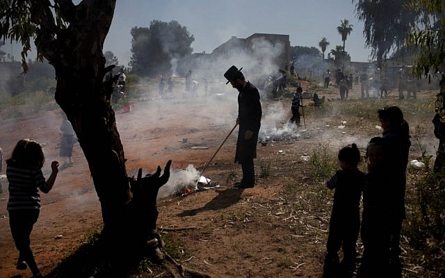 Ultra-Orthodox Jewish men burn leavened items in a final preparation before the Passover holiday in the ultra-Orthodox town of Bnei Brak, near Tel Aviv, Monday, March. 25, 2013. (Photo credit/Oded Balilty)