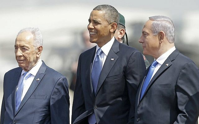US President Barack Obama, center, is greeted by President Shimon Peres, left, and Prime Minister Benjamin Netanyahu upon his arrival at Ben Gurion Airport in March (photo credit: AP/Pablo Martinez Monsivais)