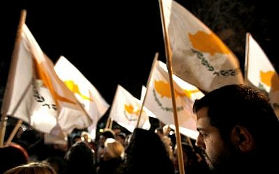 Protestors hold Cyprus' flags during a rally outside the parliament in capital Nicosia, Cyprus, Friday, March 22, 2013. (photo credit: AP/Petros Karadjias)