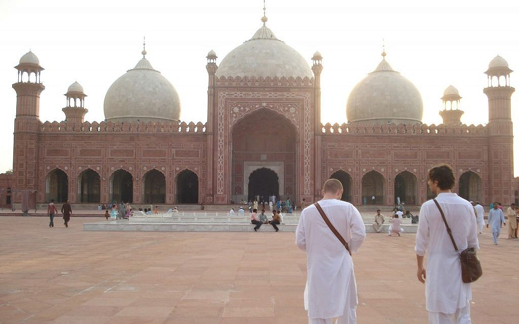 Jonathan Garfinkel, right, visits the Badshahi Mosque in Lahore, Pakistan, with director Christopher Morris. (Courtesy of Vicki Strouch)