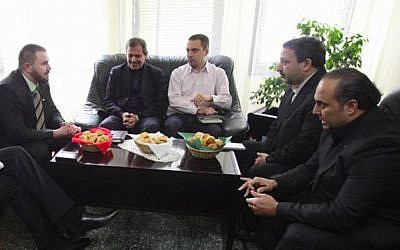 Afi Hossein Jarhomi, right, the founder of the Hungarian Iranian Business Group, attends a meeting with Jobbik chairman Gabor Vona, third from right, and visiting Iranians. (tiszavasvari.hu via JTA)