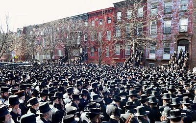 Orthodox Jewish mourners gather outside the Congregation Yetev Lev D'Satmar synagogue in Brooklyn's Williamsburg neighborhood for the funeral of Nachman and Raizy Glaube, who were killed in a car accident early Sunday, in New York. (photo credit: AP/VosIzNeias.com, Eli Wohl)