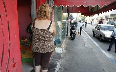 A woman stands outside an alleged brothel in south Tel Aviv (photo credit: Kobi Gideon/Flash90/File)