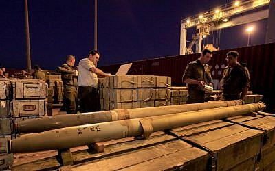 Israeli soldiers unpack rockets seized by Israeli authorities on a ship near Cyprus, and presented in the port of the Israeli city of Ashdod, Wednesday, Nov. 4, 2009 (photo credit: Tsafrir Abayov/Flash90)