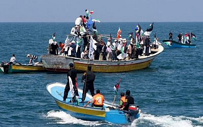 Hamas naval policemen and Palestinians prepare for the arrival of the flotilla to Gaza on May 30, 2010. (Abed Rahim Khatib/Flash90)