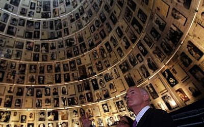Former Greek prime minister George Papandreou looks at the photographs displayed in the Hall of Names at Yad Vashem to commemorate the six million Jews killed by the Nazis during World War II. (photo credit: Kobi Gideon/Flash90)