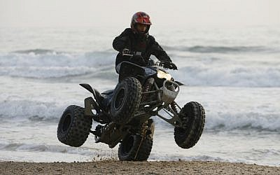 Illustrative image of a man riding an All Terrain Vehicle. (photo credit: Moshe Shai/Flash90)