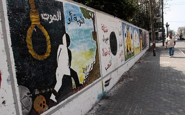 A mural in Gaza in the previous anti-collaboration campaign reads 'Repentance or death,' September 2010. (photo credit: Abed Rahim Khatib/Flash90)