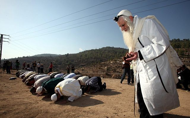 Rabbi Menachem Froman taking part in a prayer for rain with Muslims in 2011. (photo credit: Yossi Zamir/Flash90)