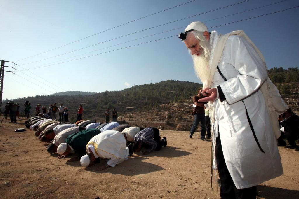 Rabbi Menachem Froman taking part in a prayer for rain with Muslims in 2011. (photo credit: Yossi Zamir/Flash90)