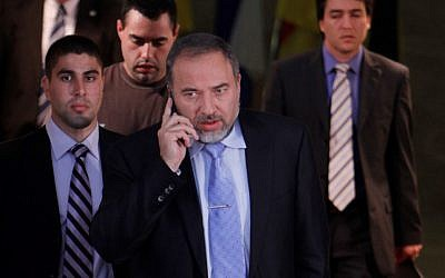 Former foreign minister Avigodor Liberman followed by his bodyguard at the Prime Minister's office in Jerusalem on January 31, 2011. (photo credit: Miriam Alster/Flash90).