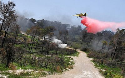 An Air Tractor AT-802 practicing aerial suppression near Beit Oren, in April 2011 (photo credit: Shay Levy/Flash 90)